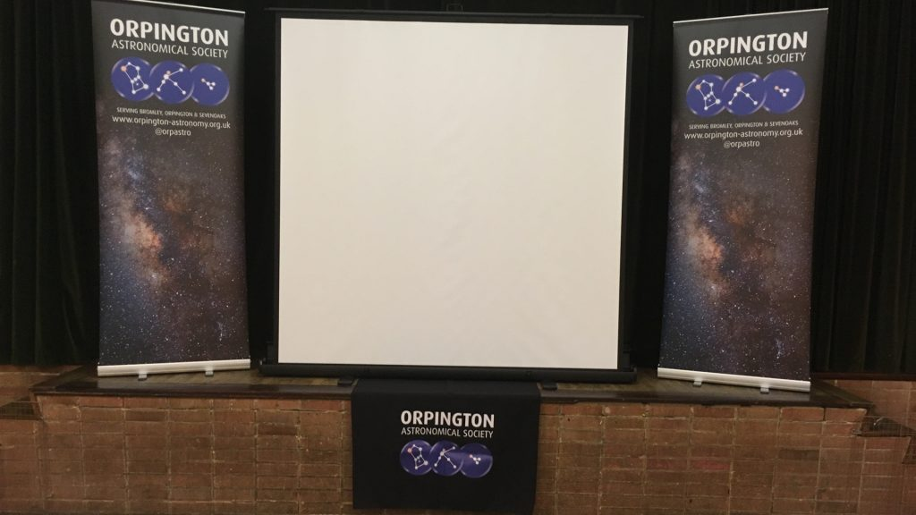 Screen and banners at an OAS meeting